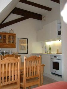 Fully equipped kitchen and dining area with welcoming bottle of dry Alsace wine
