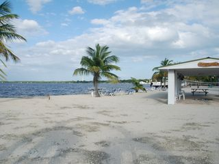 Key Largo house photo - view of beach, pavillion, picnic tables, volleyball net