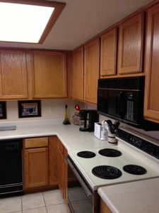 Kitchen, electric stove, microwave, coffee maker and toaster