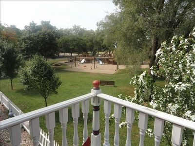 View of park play equipment looking from balcony