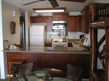 New fully equipped kitchen including new cabinets, and granite countertops.