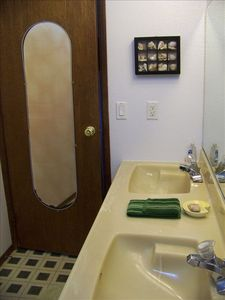 Full size bathroom with double vanity view 1