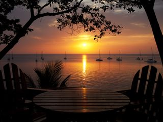 Roatan house photo - Nothing like the sunsets viewed from the deck of The Pink Orchid!