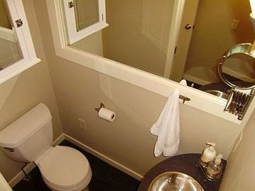 A powder room is one of the three bathrooms.