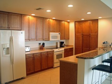 Large, fully equipped kitchen with solid surface counter tops.