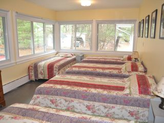 Woodstock house photo - All season Sleeping Porch features 5 twin sized beds and is perfect for a family