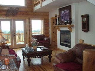 Florissant cabin photo - Cozy living room with fireplace
