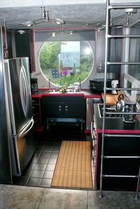 Kitchen with large stainless refrigerator/freezer, convection oven, dishwasher