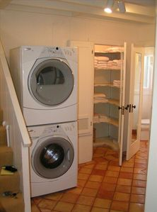 Laundry room, linen closet, full bathroom, and exterior exit to clothes line