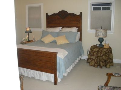 Bedroom with comfortable queen bed and down comforters.