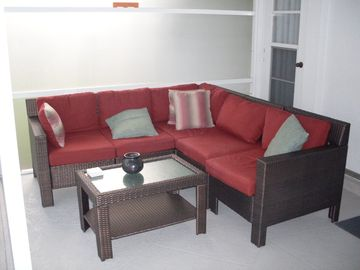 Chill out in our pool area on our rattan sofa