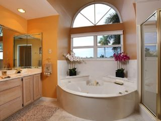Vacation Homes in Marco Island house photo - Master bath with two sinks, hot tub and walk-in shower