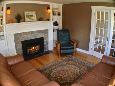 The private cozy library has french doors and 1 of 2 gas fireplaces in the home.