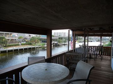Covered Deck over salt water canal watch the fish and boats go by!