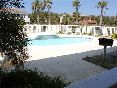 Enjoy the grill area, patio and lounge chairs when you stay home from beach..