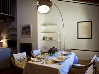 Bologna apartment photo - Welcome to Olympia! The table is set for you to enjoy.