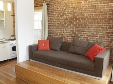 Queens studio rental - High Ceilings / Large Windows / Hard Wood Floors / Queen Tempur-Pedic Bed - Very Therapeutic / Sofa - Converts to Long Twin Bed