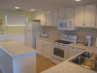 Sunnyside condo photo - Spacious kitchen fully equipped with everything needed for meal preparation.