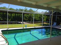 Fantastic Waterfront Home With Heated Pool And Covered Dock