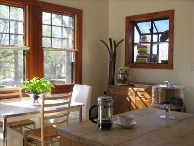 The island & kitchen nook. A french press and some coffee is waiting for you.