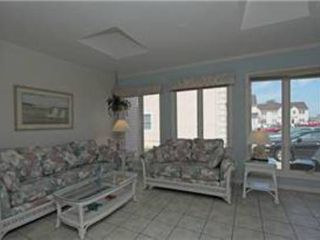 North Ocean City townhome photo - View of couches in the Sun room; queen sleep sofa is on far left. Its private.