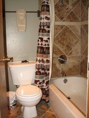 Copper Mountain condo photo - Downstairs bathroom is newly renovated with tile.