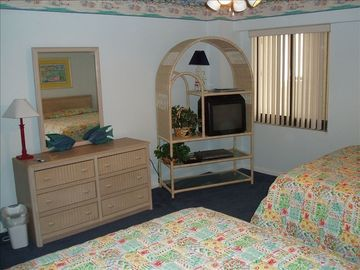 2nd bedroom showing two queen size beds