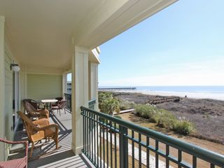 Isle of Palms condo photo - Plenty of seating for 8 guests on our deck including outdoor dining.