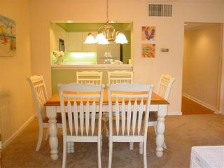 Kingston Plantation condo photo - Dining area fits the entire family! Large Pass-through window to Kitchen