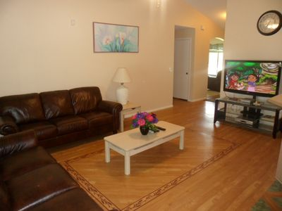 New leather sofas, hardwood floors