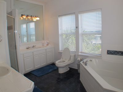 Private Master Bathroom with garden tub, walk in shower and two vanities