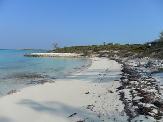 Staniel Cay cottage photo - Mid tide looking South to the little point. Cottage on the right.