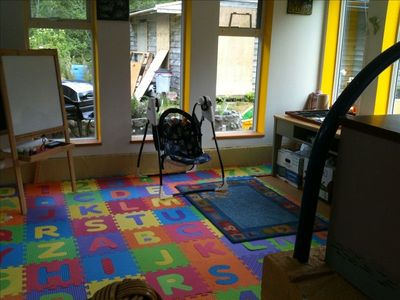 Upstairs play room, with paints, crayons, markers, and toys.