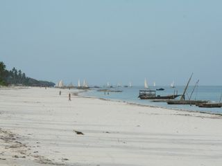 Zanzibar North villa photo - the beach and fishermen going @ work