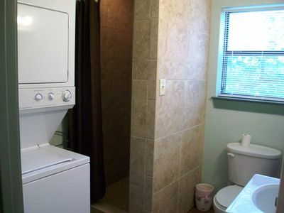 Wimberley cabin rental - Bathroom with shower and washer/dryer