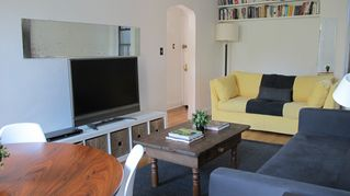 West Village apartment photo - Yellow sofa is a queen size pull out sofa - surprisingly comfortable!