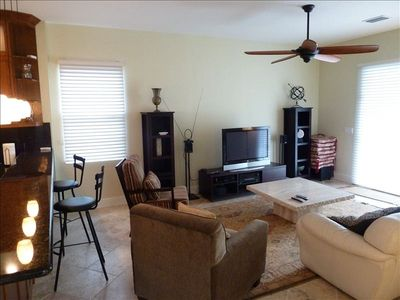 "Spacious Bar & Comfortable Living Room with Direct TV on 42"" flat-screen  TV"