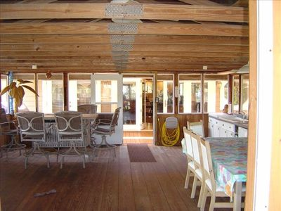 800 sq ft of Enclosed Boat House, bar, dining table, patio kitchen!