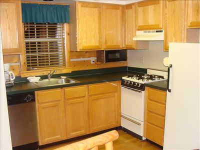 Kitchen fully stocked with Microwave, Coffee Maker, Dishwasher, Stove and Fridge