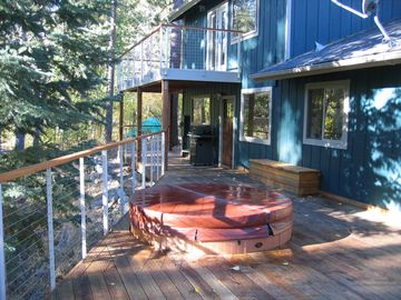the deck: you can see the door to the mudroom, the gas grill, and our spa