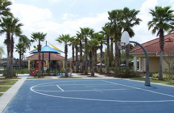 Outdoor basketball court and childs play gym with slides by the clubhouse!