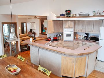 Kitchen & Dining Area with 180 Degree Water Views