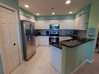 The kitchen, featuring new Samsung stainless-steel appliances