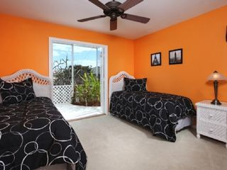 Vacation Homes in Marco Island house photo - Guest bedroom with 2 tween beds. French doors to lanai/pool area and water view