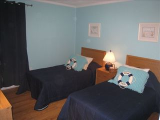 Ocean Drive Beach condo photo - BR 2 with 2 twin beds, TV and room darkening drapes.