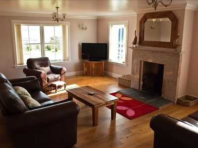 Sitting room with Leather suite,Freesat TV and Woodburning stove.