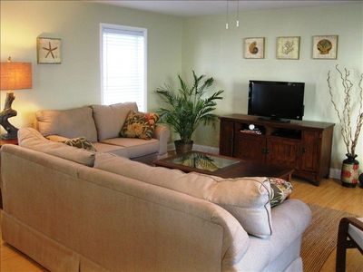 Spacious living room with all new furniture, flat screen TV, DVD player and  Wii
