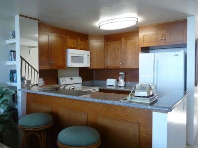 Recently upgraded kitchen with granite countertops, new appliances and cabinets