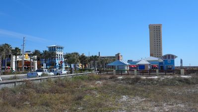 Calypso in background at entrance to Pier Park to left & fishing pier to right.