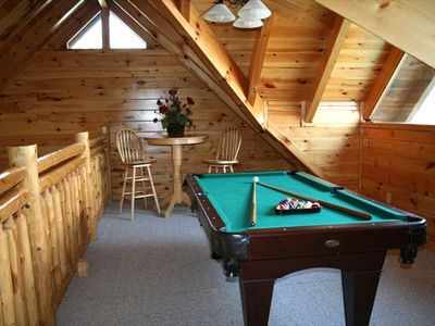Play a game of pool, watch TV, or enjoy the view from the loft